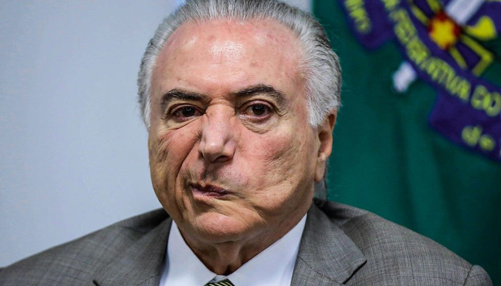 Brazil's President Michel Temer, reacts during a meeting for announcement of resources for expansion and modernisation of Brasilia subway, in Brasilia