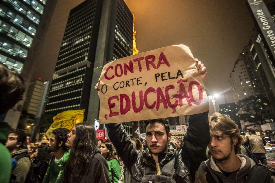 Students protest against the cut in education funding in São Paulo, Brazil, on May 18, 2016. Earlier this year, the federal government still ruled by President Dilma Rousseff decreed a cut of R $ 7 billion in education, with a reduction of 30% of funds from the federal universities. (Photo by Cris Faga/NurPhoto)