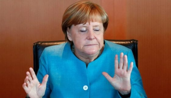 German Chancellor Merkel reacts as attends the weekly cabinet meeting at the Chancellery in Berlin