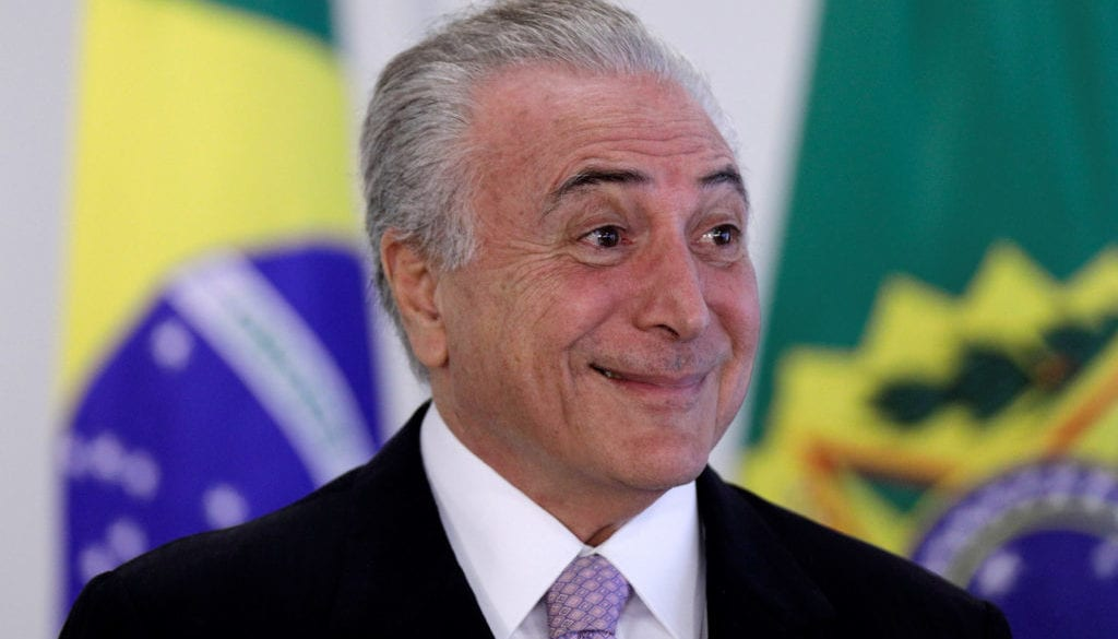 Brazil's President Michel Temer smiles during a signing ceremony of the New Decree of Port Regularization, at the Planalto Palace in Brasilia