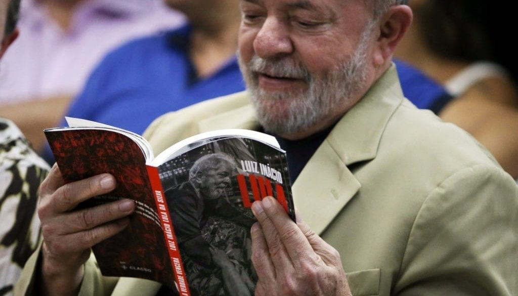 Former Brazilian President Luiz Inacio Lula da Silva holds a copy of his book during the book launch event in Sao Paulo