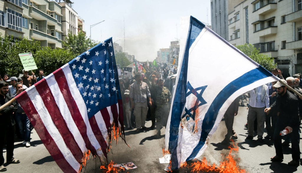Iranians burn U.S. and Israel flags during a protest marking the annual al-Quds Day (Jerusalem Day) on the last Friday of the holy month of Ramadan in Tehran, Iran
