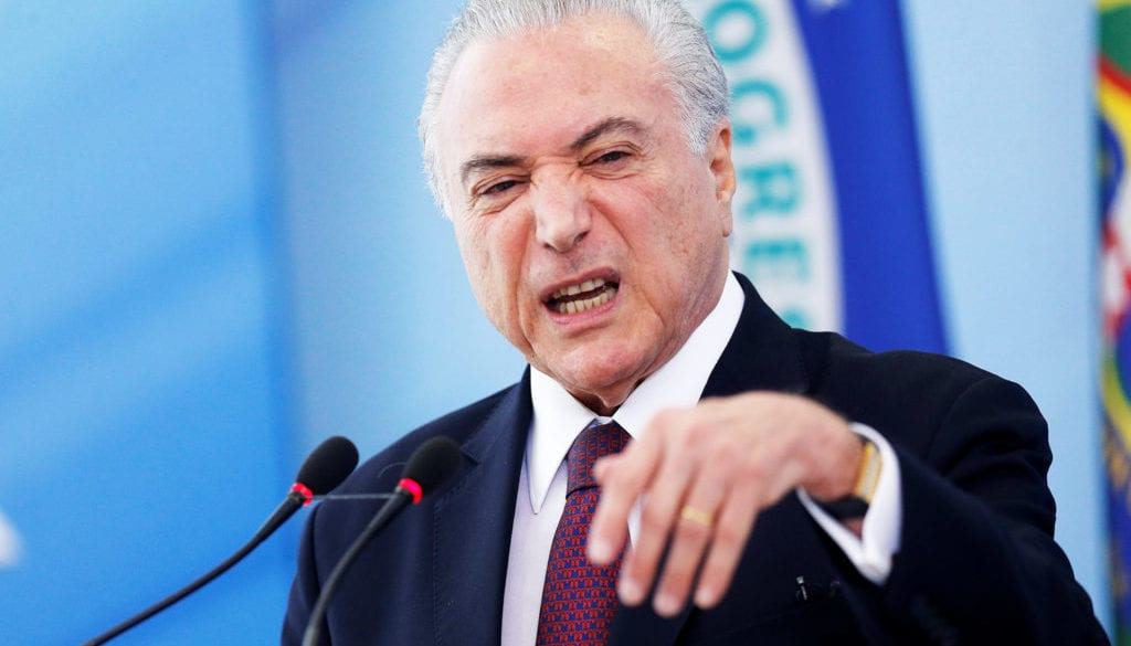 Brazil's President Temer speaks to journalists at the Planalto Palace in Brasilia