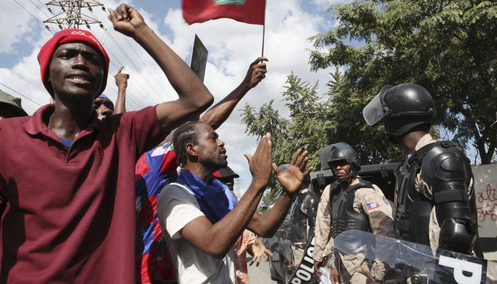 Demonstrators shout anti-government slogans in Port-au-Prince