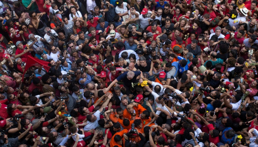 Former Brazilian President Luiz Inacio Lula da Silva is carried by supporters in front of the metallurgic trade union in Sao Bernardo do Campo