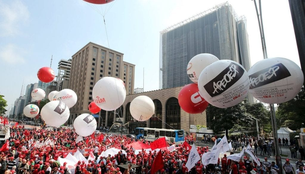 People from various social movements and union workers attend a demonstration in support of human rights and democracy at Paulista avenue in Sao Paulo financial centre