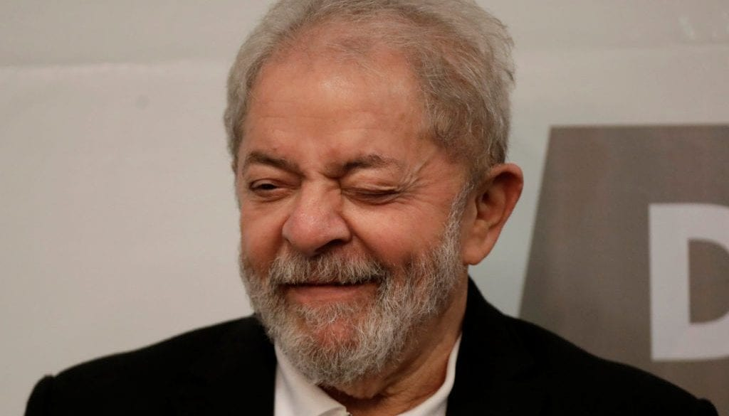 Former Brazil's President Luiz Inacio Lula da Silva reacts during a seminar on public education in Brasilia