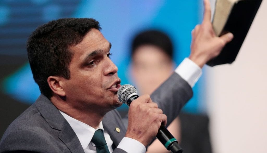 Presidential candidate Cabo Daciolo of Patriots holds the Bible during a television debate at the Rede TV studio in Osasco