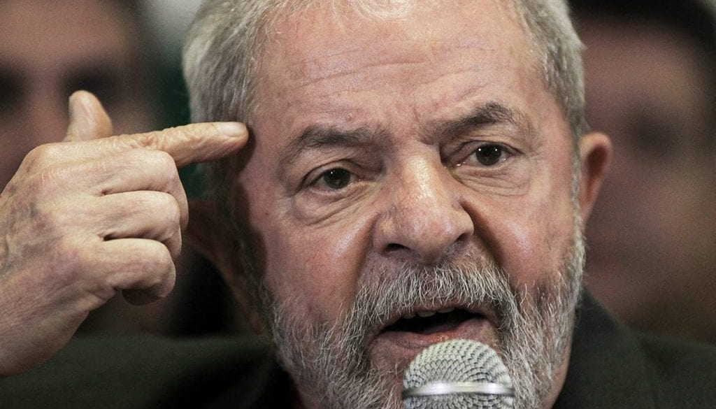 Brazil's former President Lula da Silva talks to the journalists during a press conference in Sao Paulo