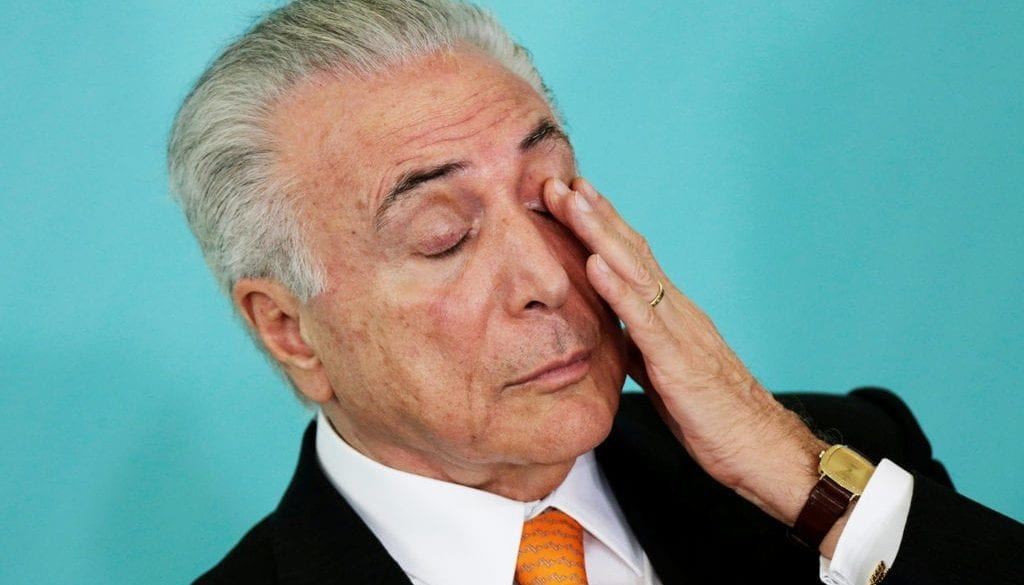 Brazil's President Michel Temer gestures during a meeting of the Council for Economic and Social Development (CDES) at the Planalto Palace in Brasilia