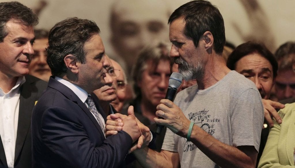 Brazil's PSDB presidential candidate Neves is greeted by PV politician Jorge as he meets governors and senators elected in the first round of the general elections in Brasilia