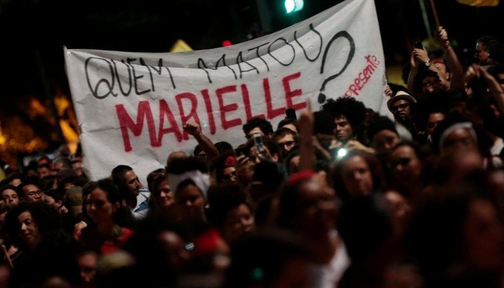 People take part in a rally against the murder of Brazilian councilwoman Marielle Franco, in Sao Paulo