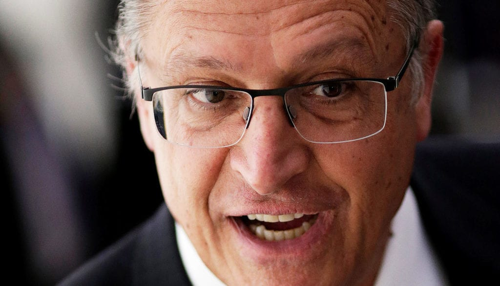 "Sao Paulo Governor Geraldo Alckmin reacts before a ceremony of the ""New School"" (Novo Ensino Medio) at the Presidential Palace in Brasilia"