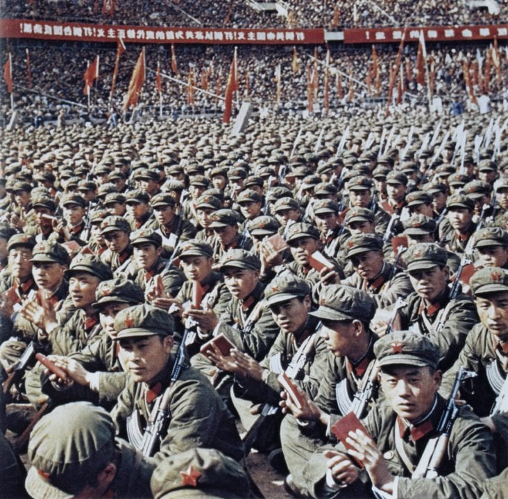 Red Guards at Rally Reading Mao Zedong's Little Red Book, Beijing, China, 1966. (Photo by: Universal History Archive/UIG via Getty Images)