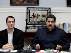 FILE PHOTO: Venezuela's President Nicolas Maduro talks next to Venezuela's Vice President Jorge Arreaza during a Council of Ministers meeting at Miraflores Palace in Caracas