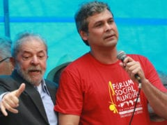 Former Brazilian President  Lula da Silva is seen next to Senator Farias during a rally in Porto Alegre