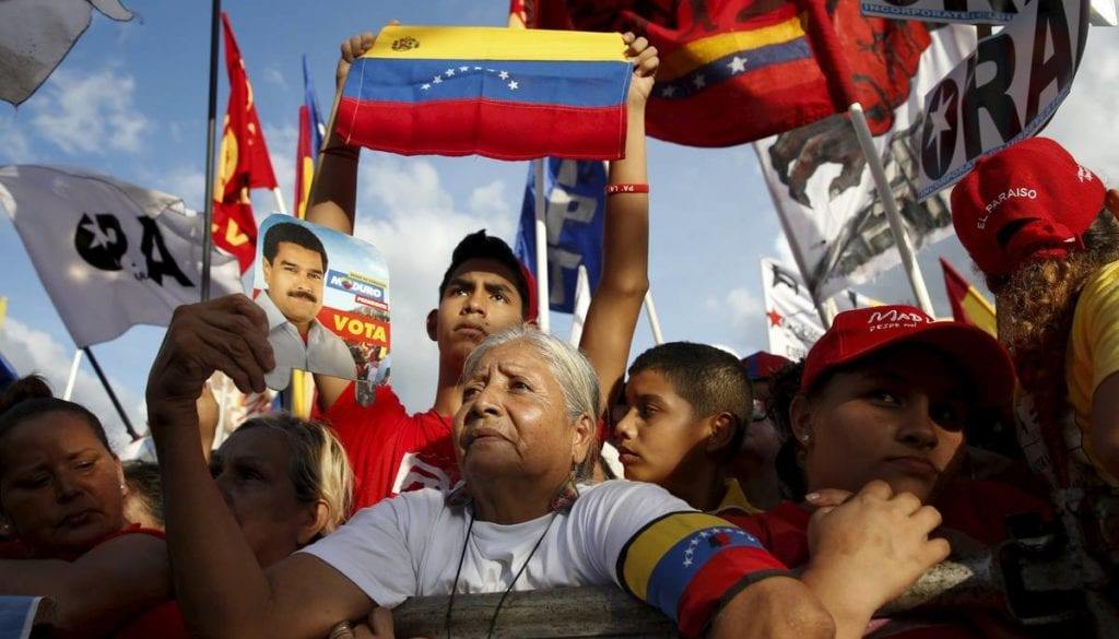 Supporters of Venezuela's President Nicolas Maduro attend to the last campaign rally with pro-government candidates for the upcoming parliamentary elections, in Caracas