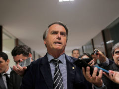 Presidential candidate Bolsonaro speaks with journalists at the National Congress in Brasilia