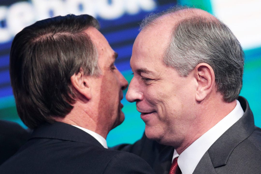 Presidential candidate Jair Bolsonaro of the Party for Socialism and Liberation (PSL) greets Ciro Gomes of the Democratic Labour party (PDT) before the television debate at the Rede TV studio in Osasco
