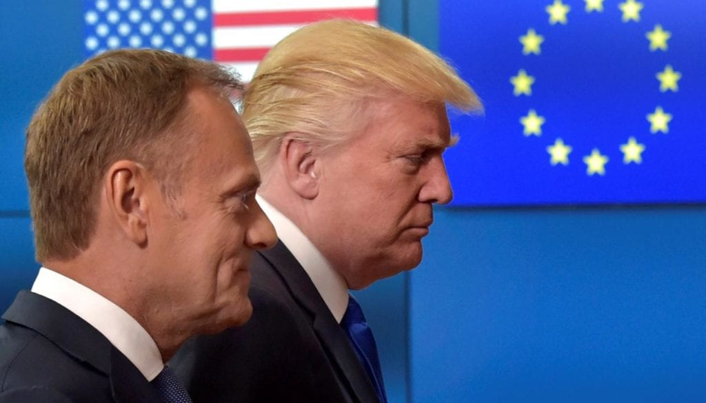 U.S. President Donald Trump walks with the President of the European Council Donald Tusk in Brussels