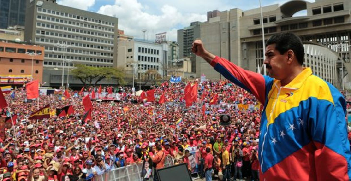ORG XMIT: MSN005 Handout picture released by the Venezuelan Presidency showing Venezuela acting President Nicolas Maduro (R) delivering a speech after registering his candidacy for the upcoming presidential election at the National Electoral Council (SNE), in Caracas, on March 11, 2013. Venezuela has entered a bitter election race to succeed Hugo Chavez, with his chosen successor branding his challenger a