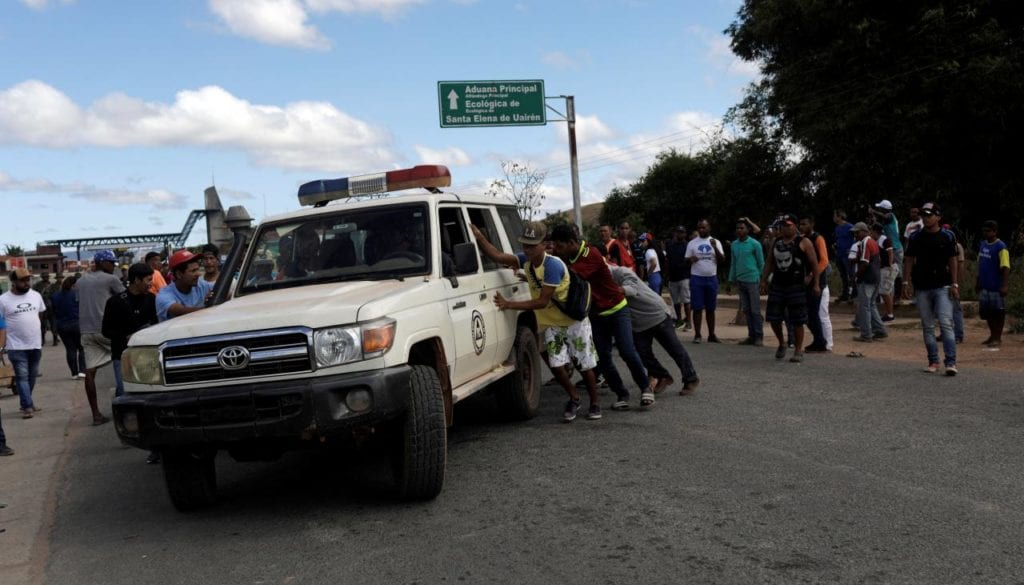 An ambulance carrying people that were injured during clashes, is assisted on the Venezuelan side at the border between Venezuela and Brazil in Pacaraima