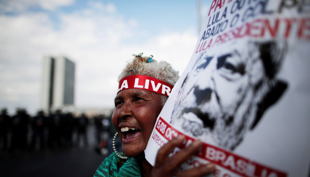 Supporters of imprisoned former Brazil's President Luis Inacio Lula da Silva attend a march before his Workers' Party (PT) officially registers his presidential candidacy, in Brasilia
