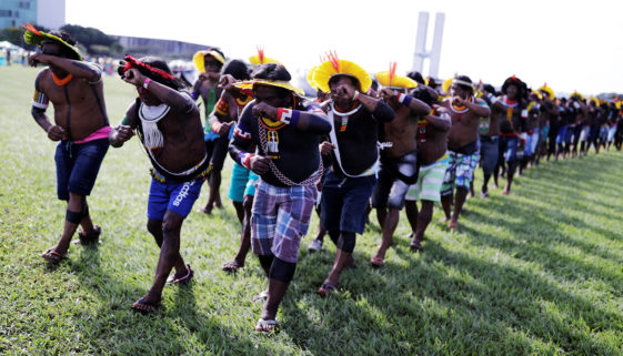 Indigenous men from the Kayapo tribe dance at the Terra Livre camp, or Free Land camp, during a protest to defend indigenous land and cultural rights that they say are threatened by the right-wing government of Brazil's President Bolsonaro, in Brasilia