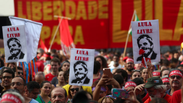 Supporters of Brazil's former president Luiz Inacio Lula da Silva demonstrate to demand Lula's freedom on the one-year anniversary of his arrest, in Sao Paulo