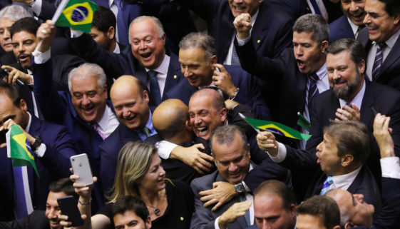 Members of Congress and supporters of the pension reform bill, celebrate the vote during a session to vote on the pension reform bill at the plenary session of the Chamber of Deputies in Brasilia