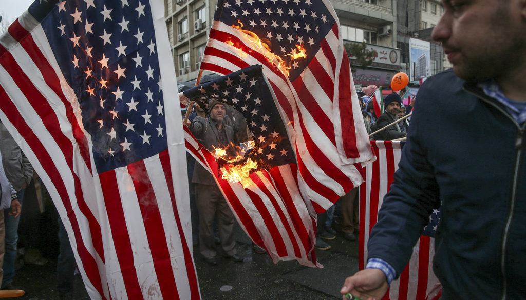 Iranians burn U.S. flags during a ceremony to mark the 40th anniversary of the Islamic Revolution in Tehran