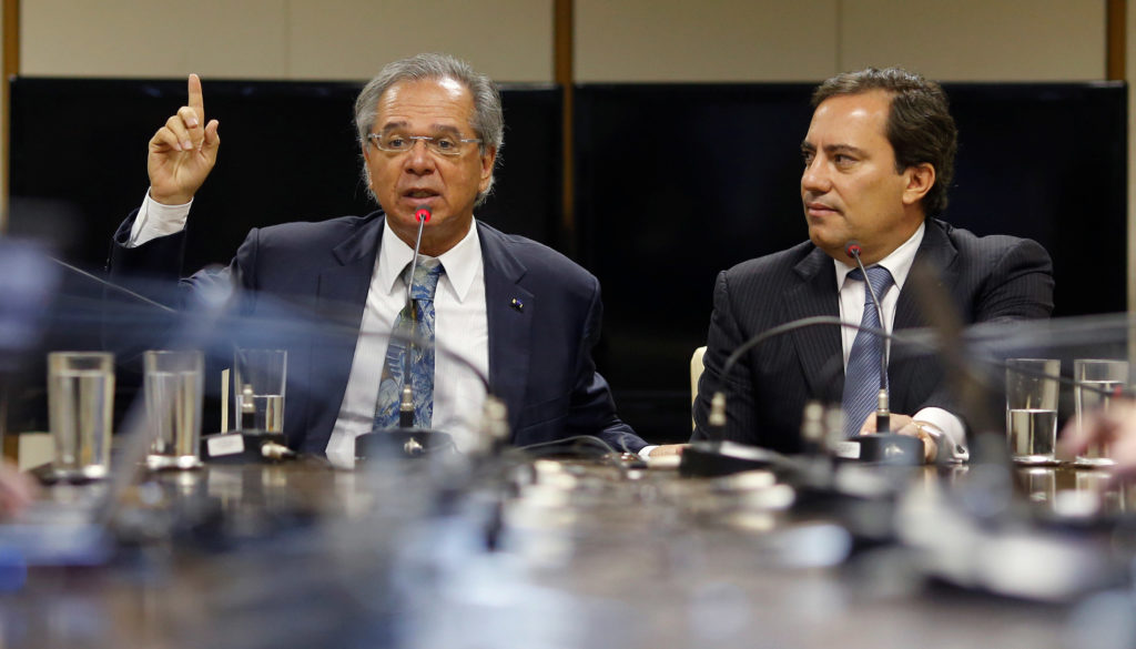 Brazil's Economy Minister Paulo Guedes and Caixa Economica Federal Bank President Pedro Guimaraes attend a news conference in Brasilia