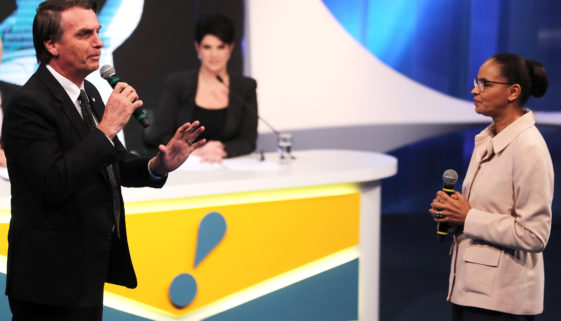 Presidential candidate Jair Bolsonaro of the Party for Socialism and Liberation (PSL) speaks next to candidate Marina Silva of the Brazilian Sustainability Network Party (REDE) during a television debate in Osasco