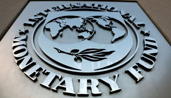 FILE PHOTO: The International Monetary Fund (IMF) logo is seen outside the headquarters building in Washington