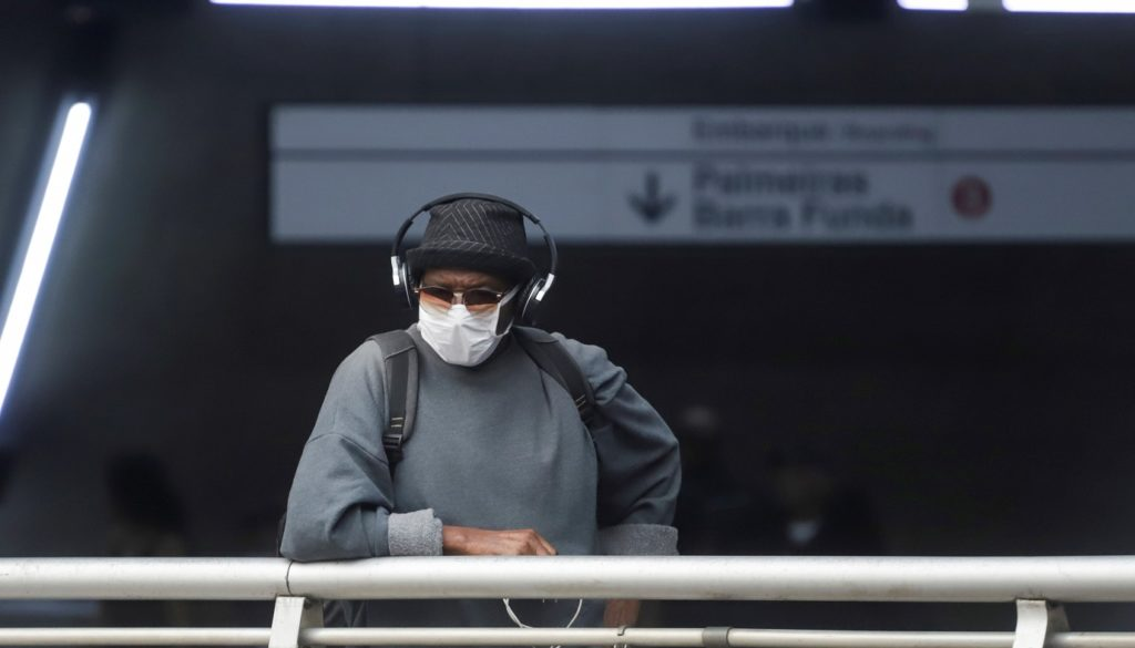 A man wears a protective face mask at a subway station after reports of the coronavirus in Sao Paulo
