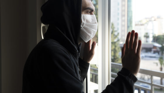 Young men isolated himself wearing a face mask quarantine himself