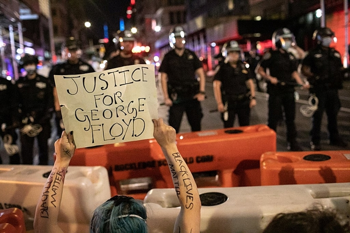 NEW YORK, NEW YORK - MAY 31: Protesters kneel in front of New York City Police during a march to honor George Floyd near Union Square on May 31, 2020 in New York City. Protesters demonstrated for the fourth straight night after video emerged of a Minneapolis police officer, Derek Chauvin, pinning George Floyd's neck to the ground. Floyd was later pronounced dead while in police custody after being transported to Hennepin County Medical Center. The four officers involved have been fired and Chauvin has been arrested and charged with 3rd degree murder.   John Moore/Getty Images/AFP