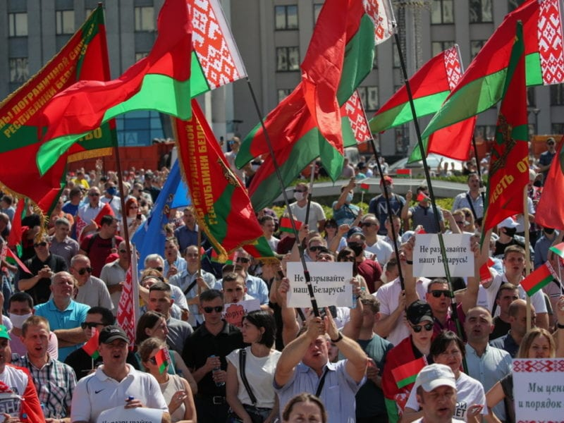 epa08606758 Supporters of Belarusian President Alexander Lukashenko wave national flags as they take part in a rally in Minsk, Belarus, 16 August 2020. Long-time President Lukashenko is under mounting pressure after unrest erupted in Belarus over alleged poll-rigging and police violence at protests following election results claiming that he won a landslide victory in the 09 August elections. As unrest continued in the country as of 15 August, Lukashenko sought the help of Russian President Vladimir Putin asking assistance in the event of external military threats to Belarus, media reported. Opposition leader Tikhanovskaya fled to Lithuania after rejecting the election results she claimed was rigged. Following the deathly crackdown on protesters, EU foreign ministers, during a video conference in Brussels on 14 August, approved sanctions against responsible officials in Belarus.  EPA/TATYANA ZENKOVICH