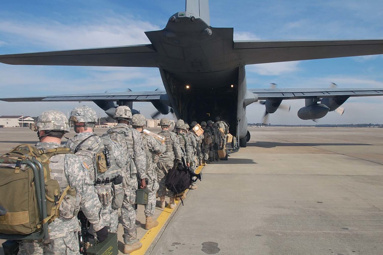 Paratroopers of Bravo Troop, 1-73 Cav, 2nd Brigade Combat team, 82nd Airborne Division board onto a C-130 Hercules aircraft at Pope Air Force Base  early Thursday morning Jan 14, to deploy in support of the earthquake that occurred in the  capital of Port-au-Prince, Haiti earlier this week.  The 2nd BCT is the 82nd Airborne Division's Global Response Force that has been training for real world emergency response missions.  These are the first group of paratroopers going to Haiti to provide Humanitarian Aid.