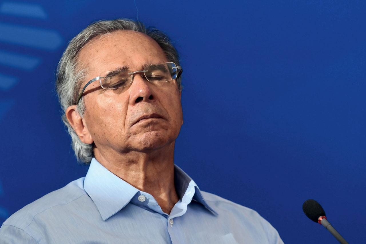 (FILES) In this file picture taken on April 3, 2020 Brazil's Minister of Economy Paulo Guedes gestures during a press conference at Planalto Palace in Brasilia. - Guedes, the powerful free-market guru to far-right President Jair Bolsonaro, said on August 11, 2020 that two of his top deputies had resigned in a