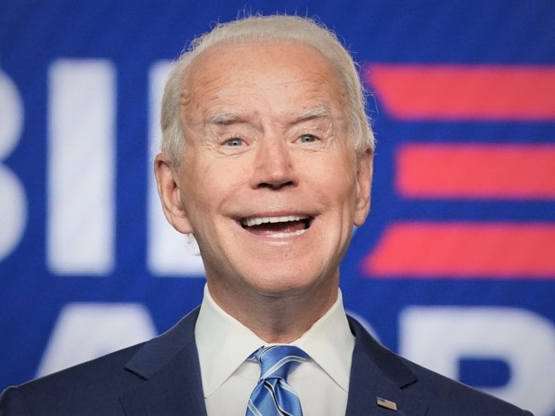 Democratic U.S. presidential nominee Joe Biden smiles as he speaks about the results of the 2020 U.S. presidential election during an appearance in Wilmington, Delaware, U.S., November 4, 2020. REUTERS/Kevin Lamarque     TPX IMAGES OF THE DAY