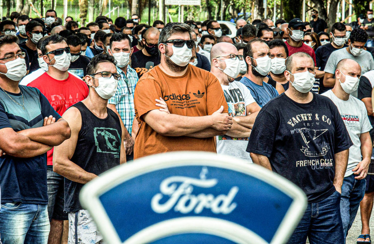 Workers wearing face masks attend a general meeting with the labor union outside a Ford Motor Co plant, after the company announced it will close its three plants in the country, in Taubate, Brazil, January 12, 2021. REUTERS/Carla Carniel NO RESALES. NO ARCHIVES