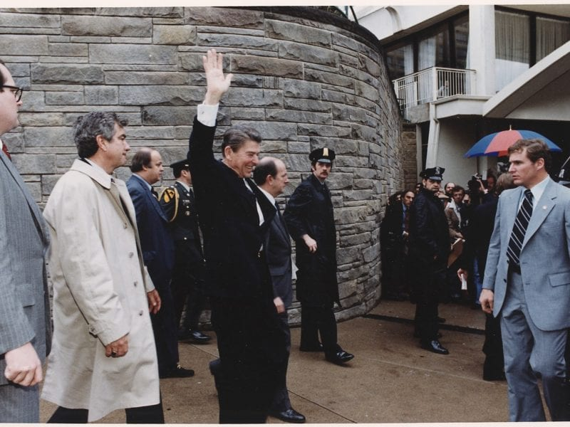 lossy-page1-1280px-Photograph_of_President_Reagan_waving_to_crowds_immediately_before_being_shot_in_an_assassination_attempt,_Washington..._-_NARA_-_198513.tif