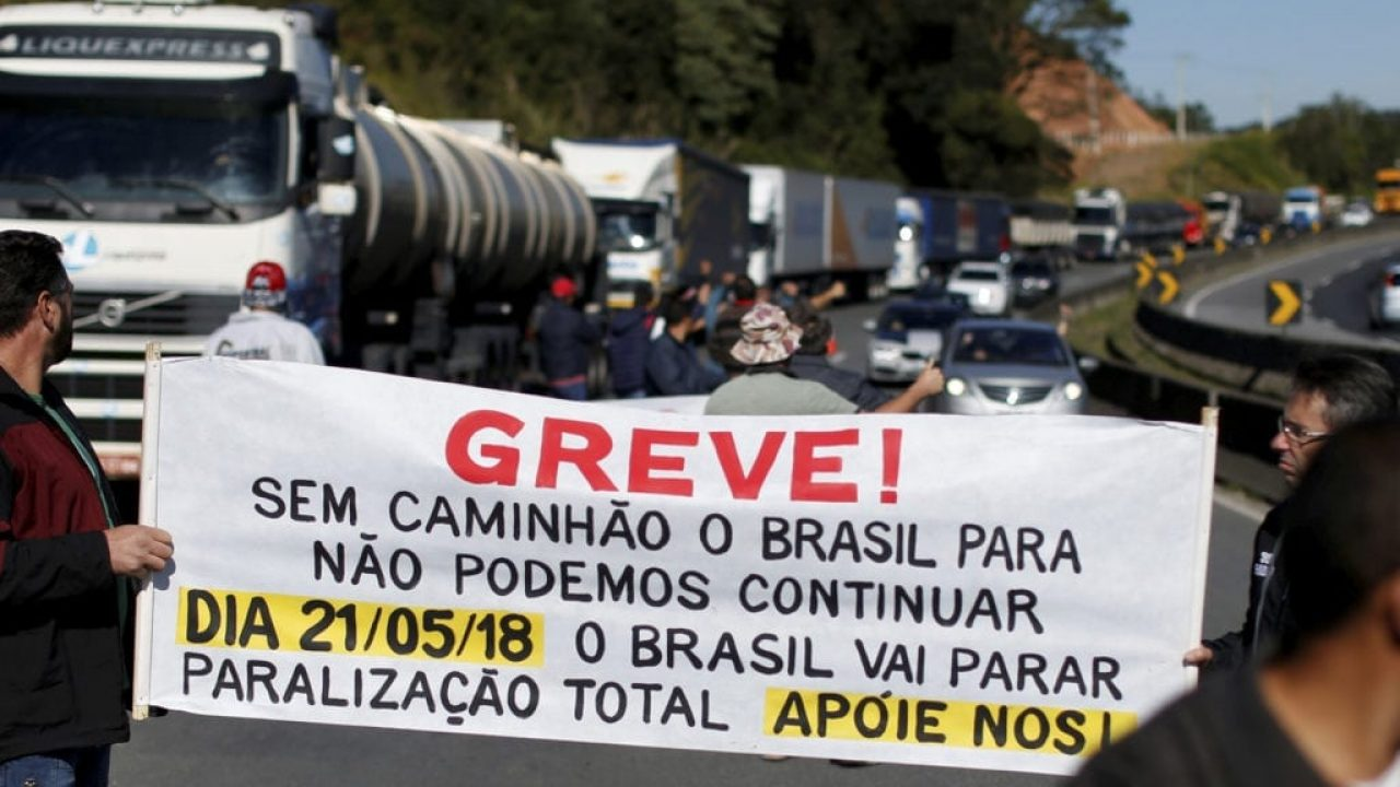 Brazilian truck drivers blocked the BR-116 highway with their trucks during a strike in Curitiba, Brazil May 21, 2018. The banner reads: